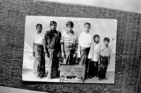 A photograph taken by Burmese authorities of a Rohingya family in Rakhine State in Burma. The entire family eventually fled to Bangladesh in 2009. In Burma, authorities closely monitor Rohingya families. Most Rohingya are not permitted to travel beyond their village. Family household registers are updated regularly so the authorities know how many Rohingya are in each house. Any discrepancies with these records are punishable by fines and arrest (2009). Copyright: Greg Constantine