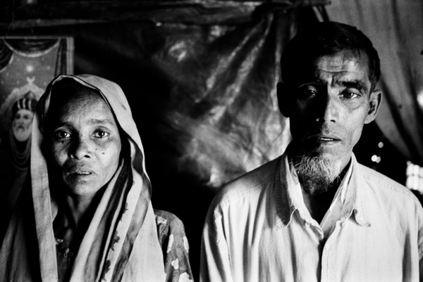 To escape from the desperate situation in Bangladesh, thousands of Rohingya have paid brokers to smuggle them by boat to Malaysia via Thailand. In early 2009, hundreds of Rohingya on boats were intercepted by the Thai military and pushed back out to sea to an uncertain fate with little food or water, and no engines. The parents of 27-year-old Mohamed have not heard from him since he got on a boat in early December 2008 (2009). Copyright: Greg Constantine