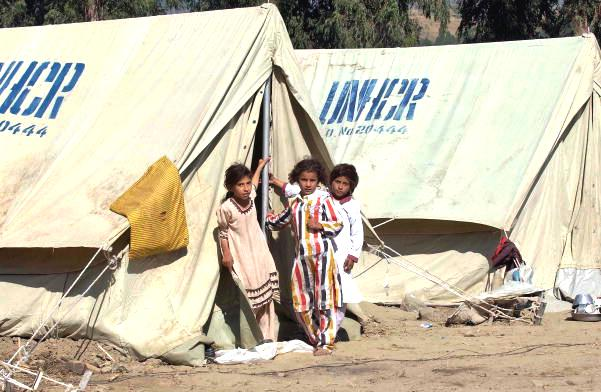 Refugees in Kashmir outside temporary housing provided by the UNHCR Flickr/ United Nations Photo