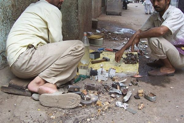 Dismantling electronic waste in New Delhi Source: Wikimedia Commons