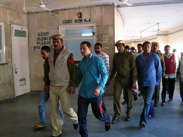 The workers being brought to the district court in February 2015. Photo: Anumeha Yadav