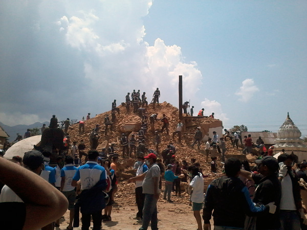 Volunteers and police personnel at work in clearing the debris at Kathmandu's Kalmochan temple. Photo: Shubhanga Pandey