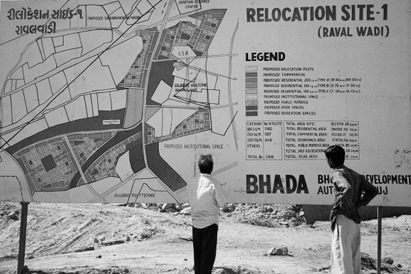 Caption: A signboard showing the new layout of the town in 2004, Bhuj. Photo: Edward Simpson