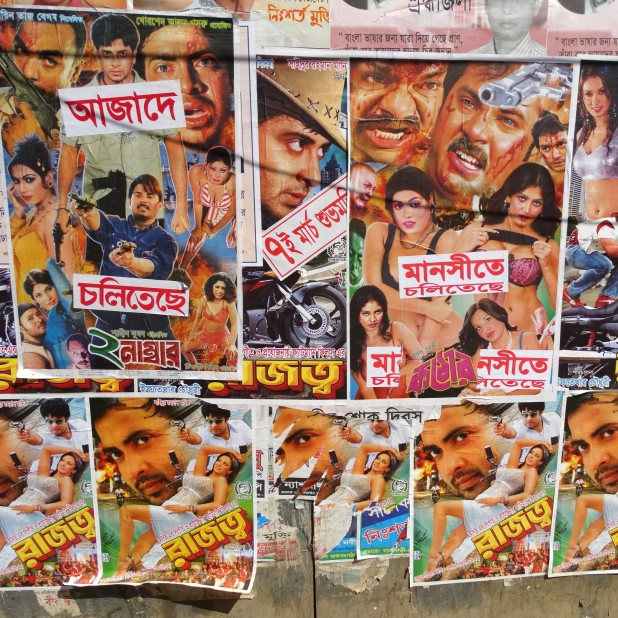 Movie posters on the walls of Dhaka. Flickr / Adam Jones