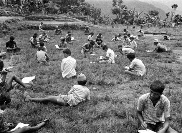 Students take their exams on the school playground in Chiti Tilahar. To prevent cheating, Sumitra Manandhar Gurung and fellow teachers had made the students sit several feet away from one another. This photograph was part of the exhibition 'Time Maps and Memories' focused the life and times of its collector — Sumitra Manandhar Gurung — well-known in Nepal for untiring work to bring about change in the lives of deprived and marginalized groups.