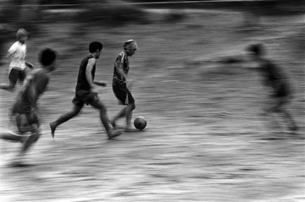 Refugees in Mae La camp in Thailand let off steam during the football World Cup in 2006. There are more than 140,000 refugees on the Thai-Burma border. Thailand, 2006.