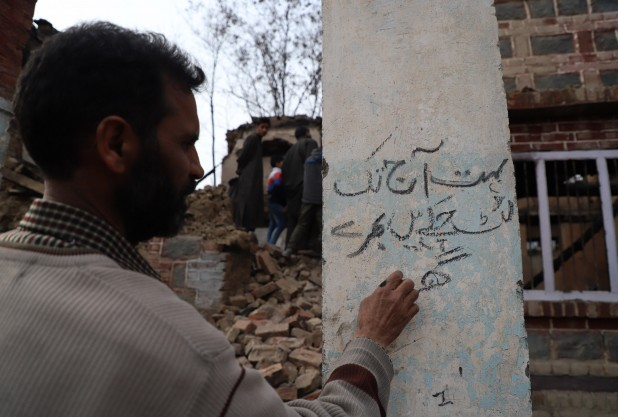 """A couplet on a pillar of his house that Bhat wrote with a piece of charcoal from the rubble. The lines read: """"Countless prosperous homes have been plundered; now the loyal are being butchered."""""""