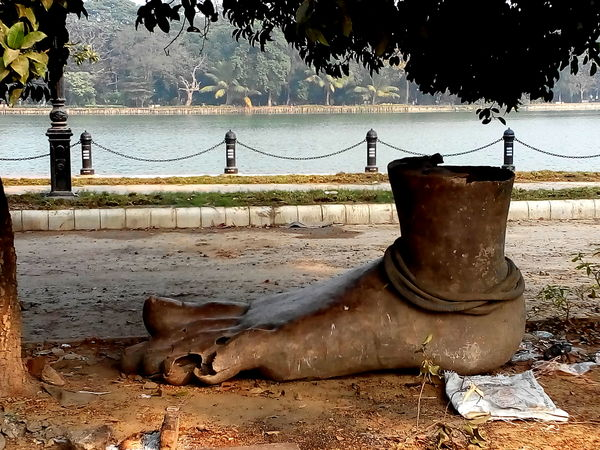 Prized found object: a broken-toed metallic sculpture of a foot lying within view of the lakes. These are likely to be remnants of idols discarded by a 'museum' of Durga idols set up in the vicinity.