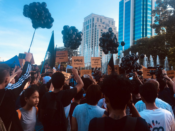 Youth activists protest the imprisonment of journalists Wa Lone and Kyaw Soe Oo, who were reporting on the killing of the Rohingya by the country's armed forces.