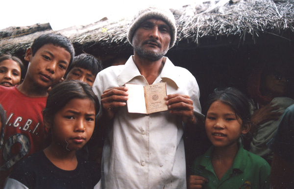 A Lotshampa refugee at a camp in Jhapa District of eastern Nepal showing his Bhutanese passport. Photo: Alemaugil / Wikimedia Common