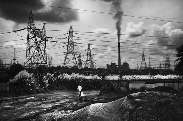 The air around the Tayo Rolls coal factory in East Singhbhum is difficult to breath. But the factory is one of the few sources of daily employment for the workers from place Raghunathpur. Jharkhand, India. August 2016.