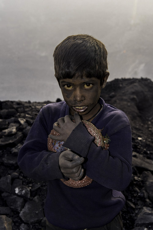 A boy in the coal fields of Jharia, likely from a family of migrant workers from neighbouring farming communities. Jharkhand, India. November 2017.