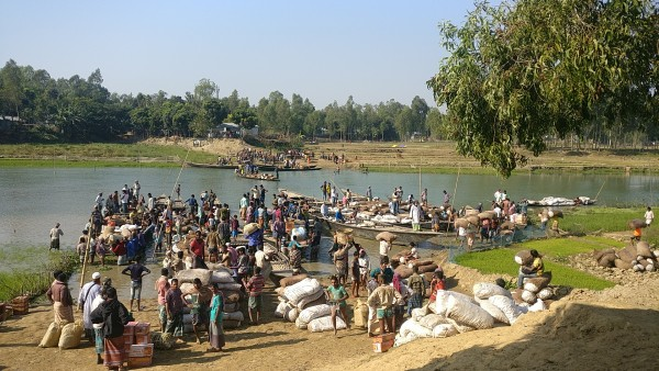Vendors and customers busy moving goods from the haat towards Kurigram in Bangladesh.