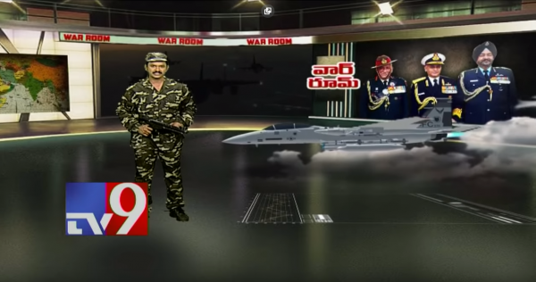 A Telugu news anchor from TV9 sporting combat fatigues and a toy gun for a broadcast on the Pulwama attack. Photo: TV9 Telugu Live / YouTube