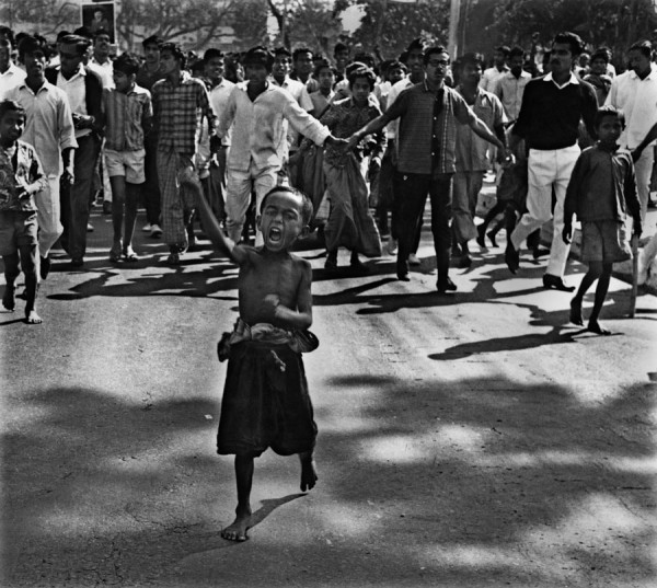 """A street child, or ""tokai"" leads a procession during the mass uprising of 1969. Police bullets killed the child soon after the photograph was taken. Dhaka, 1969"" by Rashid Talukder. Photograph courtesy: Rashid Talukder / Drik Picture Library / Chobi Mela"