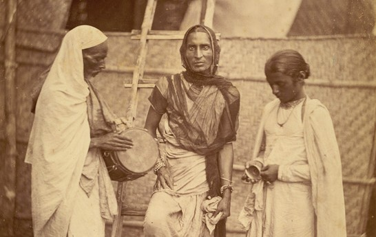 A Hijra with her companions in the 1860s, somewhere in eastern Bengal. Photo: The British Library