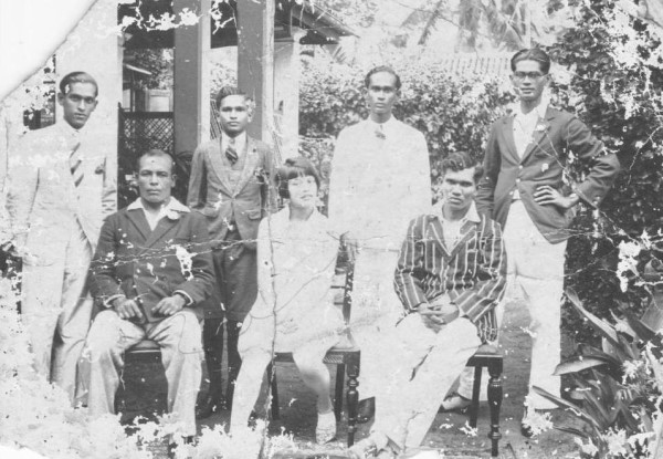 Mass J Majid (standing left corner) on the occasion of his uncle, boxer Maas Amoo (seated far right in striped blazer) hosting his trainer at their residence in Colombo, 1928. Photo courtesy Maas J Majid.