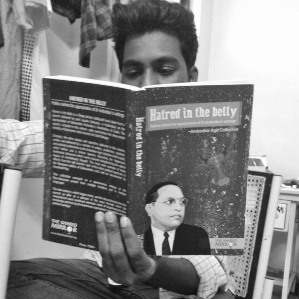 Rohith Vemula reading 'Hatred in the belly', a collection of essays by Dalit intellectuals. Photo adapted from Ashok Kumar Kolagani / Facebook